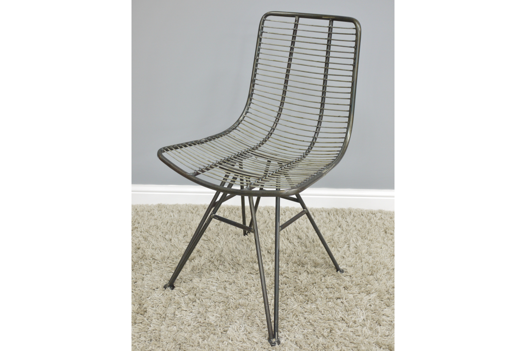 Pair of caged metal industrial dining chairs.