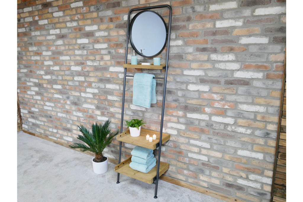 Tall industrial metal and wood wall ladder display shelving unit with mirror.