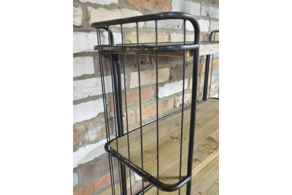 Tall Industrial metal and wood caged baker shelf storage cabinet on wheels.