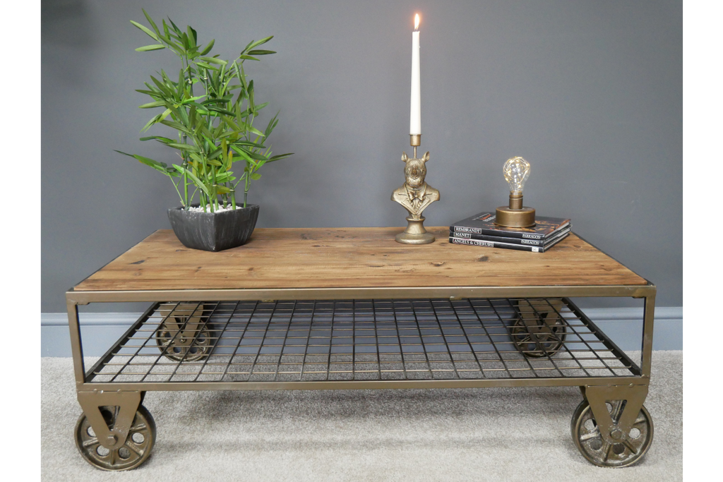 Industrial rustic coffee table on wheels.