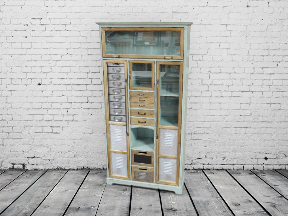 Tall green wooden multi drawer storage cabinet.
