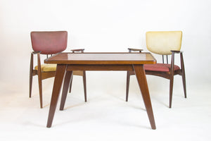Set of 4 armchairs and a table by Michel Arnoult