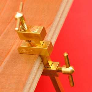 Close-up KAKURI Hatagane Brass bar clamps clamp made in Japan wood close up