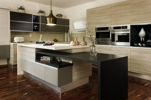 Apartment kitchen with wood accent