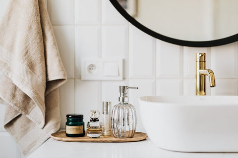 Wooden tray on top of bathroom sink