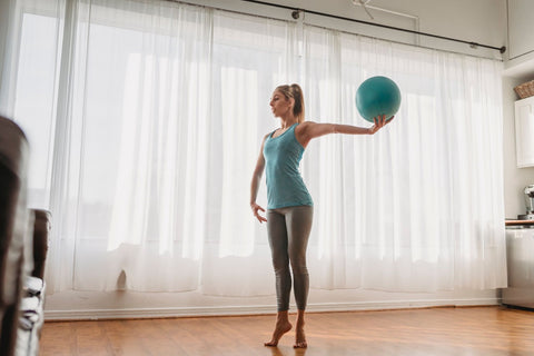 woman holding a gym ball