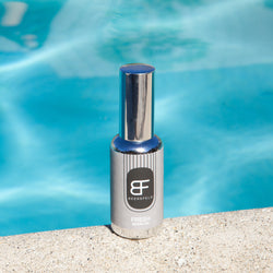 BEERSFELD 50 ml / 1.7 oz fresh beard oil in glass chrome bottle with a grey label by blue pool water
