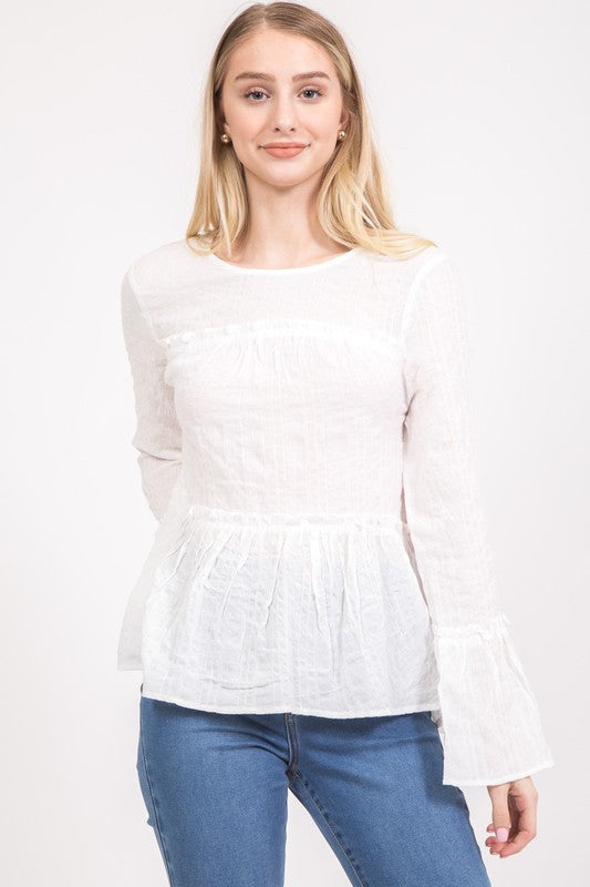 Shop Tinsley White Long Sleeve Top Our Tinsley White Top delivers a simple and delicate look. Great paired with your favorite denim skinnies! Rounded Neckline Tie Top Back Bell Wrist Sleeves Crinkle Material 42.00 USD // ShopBellaAllure.com