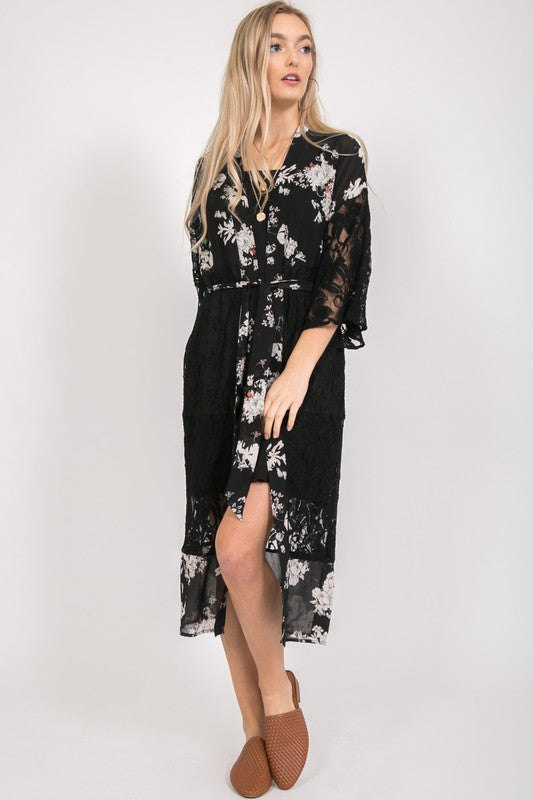 Shop Flowers & Lace Black Kimono Dress This is the absolute best twist on a dress and kimono! With the perfect amount soft flower embellished material this number pairs perfectly with delicate lace. Add a cute front tie and this one is perfect for all occasions! Delicate sheer lace Small slip Waist tie belt 28.00 USD // ShopBellaAllure.com
