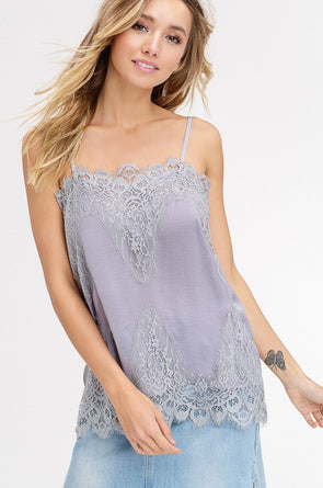 Shop Bradshaw Lace Grey Cami Sometimes the most delicate things in life gives off the loudest statement! This simple lace piece is a mandatory layering piece that dresses up all outfits. Adjustable straps that provide full coverage Delicate and dreamy Soft satin feel Lace hemlines Silvery grey color 18.00 USD // ShopBellaAllure.com