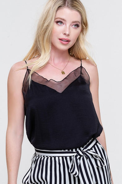 Shop Secret Black Cami The crowd pleasing essential! This silky camisole top is a perfect switch from the office to cocktails at night! Silky slight V-neck Lined sheer detail Adjustable straps  Lightweight True to size 36.00 USD // ShopBellaAllure.com