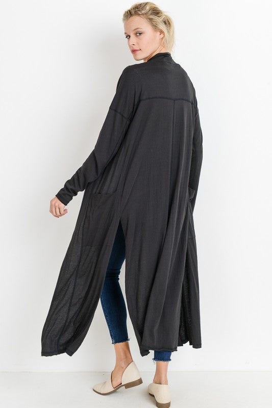 Shop Seaside Lightweight Black Cardigan This lightweight cardigan is the perfect grab and go with style. Its light, versatile, and stylish features match any outfit! Double stitching Long fitted sleeves Mid-thigh side slits  38.00 USD // ShopBellaAllure.com