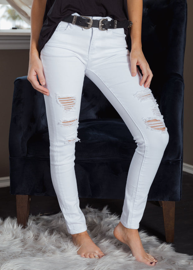 Shop On Cloud 9 Skinny Jeans We are obsessed with our On Cloud 9 Skinnys! The perfect mid-rise white denim skinny jean for spring and summer! The distressed style and comfort fit will have you feeling like your on cloud 9! White denim Distressing Slight stretch 48.00 USD // ShopBellaAllure.com