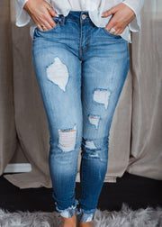 Shop Kyle Skinny Jean Our Kyle Jean is the new must have staple in your closet! These perfectly distressed jeans look amazing and feel like your favorite pair of yoga pants . Mid Rise Distressed Medium Blue Wash 52.00 USD // ShopBellaAllure.com