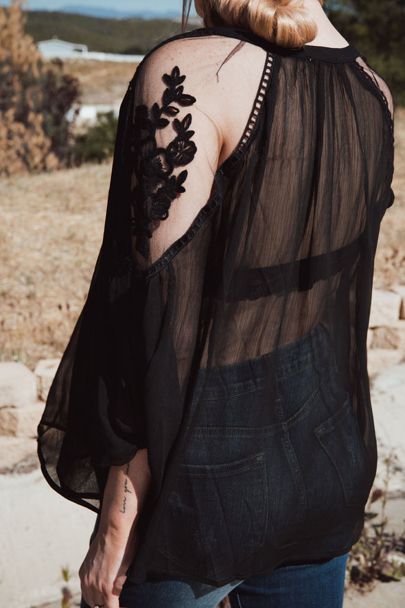 Shop Pretty Peasant Black Top Were so in love with our Pretty Peasant top. This lightweight flowy top adds a soft feminine touch to your basic denim. Be prepared and look your best in this dreamy blouse. Relax Lightweight Fit Sheer Lace Inserts on Sleeves Tie neck line 24.00 USD // ShopBellaAllure.com