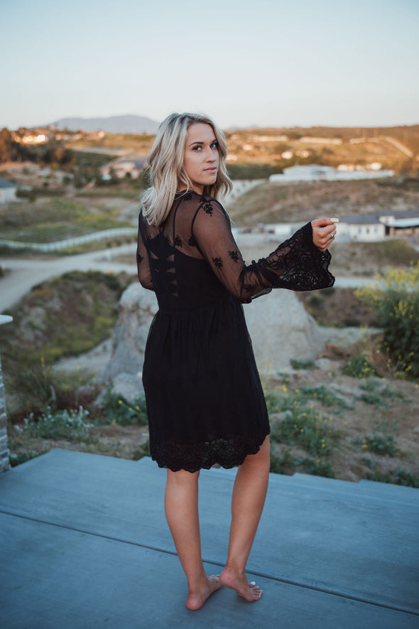 Shop Priscilla Sheer Long Black Cardigan * Beautiful Lace Design * Tie String Waist with Tassel  * Bell Sleeves * Scalloped Bottom Styled with our Monica Dress.  Lexi is 54 wearing a size Medium.    42.00 USD // ShopBellaAllure.com