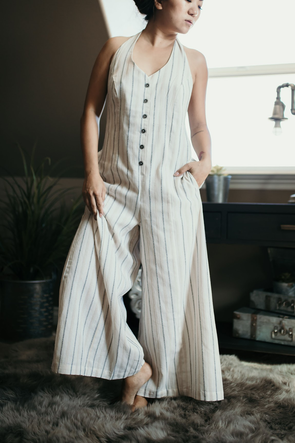 Shop Take Me To Paris This button down halter jumpsuit is everything! One of our favorites! The neutral colors, side pockets and overall style of this piece is amazing! 52.00 USD // ShopBellaAllure.com