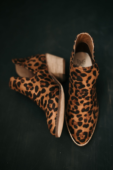 Shop Sunny Leopard Bootie We are all heart eyes for these faux leopard ankle booties. With a slide slit peek a boo to show off your style these pair perfect with any outfit! Youll definitely be on the prowl with these ones. Small wood stacked heel Leopard faux suede  Side slit  48.00 USD // ShopBellaAllure.com