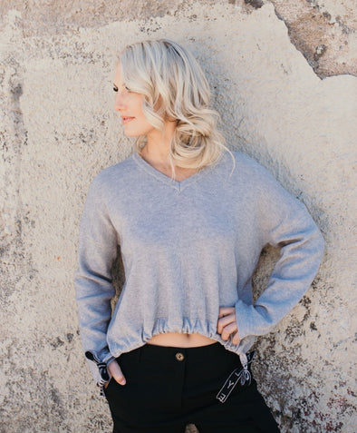 Shop Eliot Top Put your cold weather blues to ease with our Eliot Top. This knit pull style top features a soft heather grey color with a gathered pull string waist. A soft casual piece that just may become your favorite! 46.00 USD // ShopBellaAllure.com