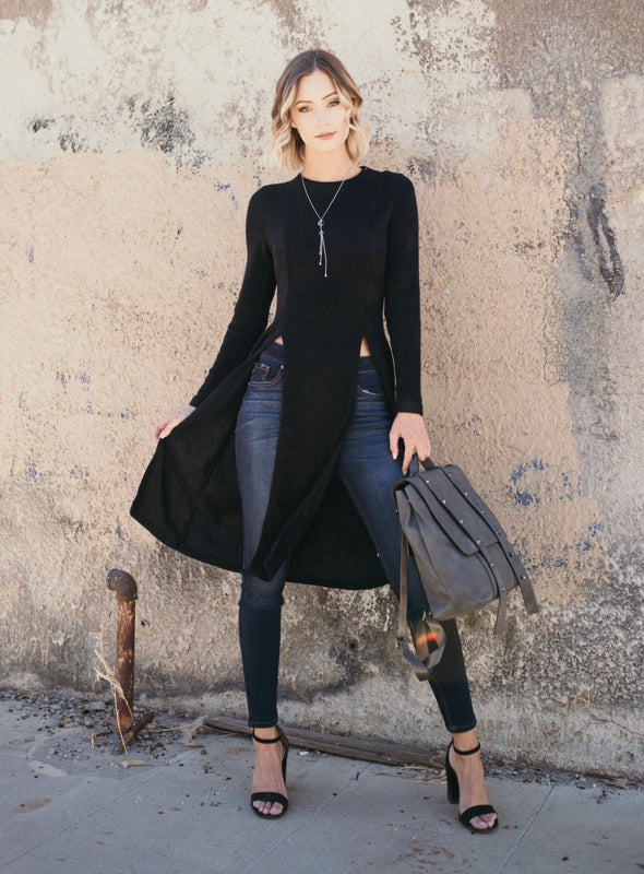 Shop Axton Sweater Top Black Ok Ladies, This will become your new favorite top for sure! So edgy, so fun, so full of style! Our Axton Sweater Top will have heads turning. Featuring a lightweight knit material and two side slits to the waist - its a sure trendsetter! 46.00 USD // ShopBellaAllure.com