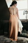 Shop Central Park Dress Our Central Park Dress is giving us some Boho vibes! With its halter tie top and open back this long maxi like dress features a slip underneath and two front/side slits. The fun fall cinnamon color just tops off the warm look! 46.00 USD // ShopBellaAllure.com