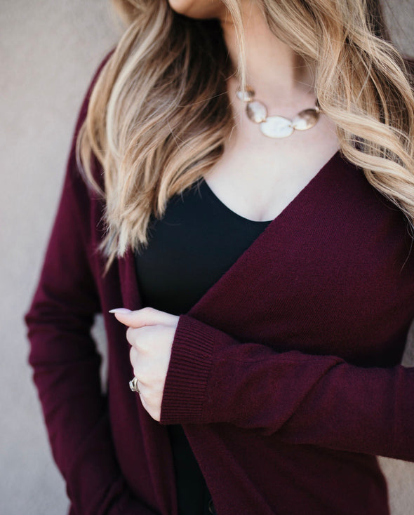 Shop Tres Bien Cardigan Maroon This classic style cardigan is perfect as we move into the cooler weather. Easy to pair with most outfits and adds a pop of color! 42.00 USD // ShopBellaAllure.com