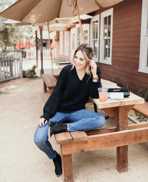Shop Hampton Sweater This woven black V-neck sweater is casual, comfortable and versatile. Its a medium knit and can keep you warm while not being overly bulky. Coffee date or Date night with the right jeans it is a must have! Heavy yet breathable material Cuffed sleeve Relaxed fit V-neck  38.00 USD // ShopBellaAllure.com