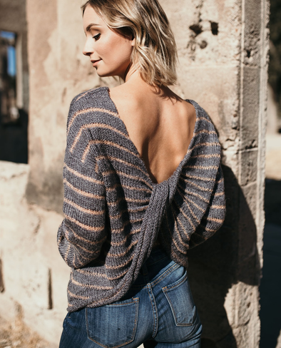 Shop Cora Sweater Let us get your ready for the season with our Cora Sweater. This sweater features  a charcoal and cream strip pattern and a twisted back detail that is sure to please! 38.00 USD // ShopBellaAllure.com