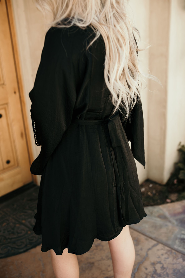 Shop Gizelle Dress This fun kimono style mini dress is stunning! Features a shimmery, silky material with a great feel, bell sleeves and has a belted tie back. This dress is lined. With such an amazing look this will be your go to little black dress!! 54.00 USD // ShopBellaAllure.com