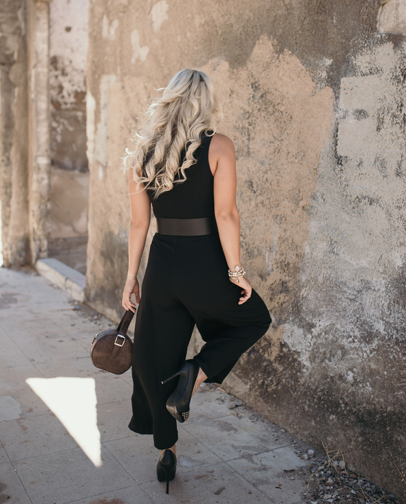 Shop Kieran Jumpsuit This gorgeous black jumpsuit will have you ready for any occasion!  Well made with a sleeveless crew neck top and wide legs this piece comes with a scarf belt that is removable. Add some heels and look your best! 65.00 USD // ShopBellaAllure.com