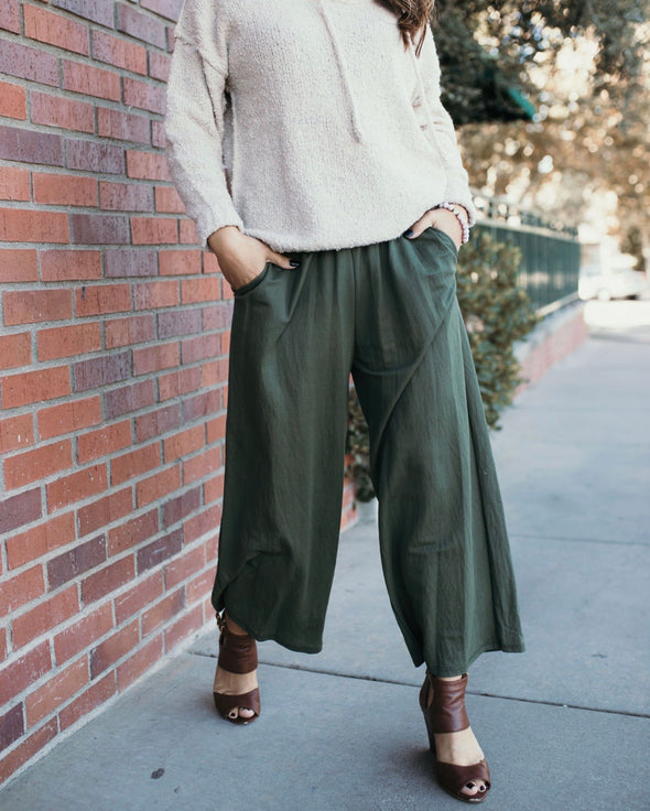 Shop Roland Pants Olive Our Rowan Pants offer a chic style and comfortable fit. These pants have a subtle sheen fabric and can be dressed up or down. Designed with a relaxed fit, cinched waistline and wide leg. Side pockets add to the style. You will love the versatility of these pants!  38.00 USD // ShopBellaAllure.com