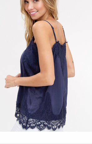 Shop Bradshaw Lace Navy Cami Sometimes the most delicate things in life gives off the loudest statement! This simple lace piece is a mandatory layering piece that dresses up all outfits. Adjustable straps that provide full coverage Delicate and dreamy Soft satin feel Lace hemlines Vintage navy color 18.00 USD // ShopBellaAllure.com