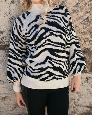 Shop Zinnia Sweater Our Zinnia Sweater showcases an exclusive snake print in black and cream on a thick knit base. This sweater offers a crew neckline with a relaxed fit. A fun little piece that will keep you warm and cozy this season! 48.00 USD // ShopBellaAllure.com