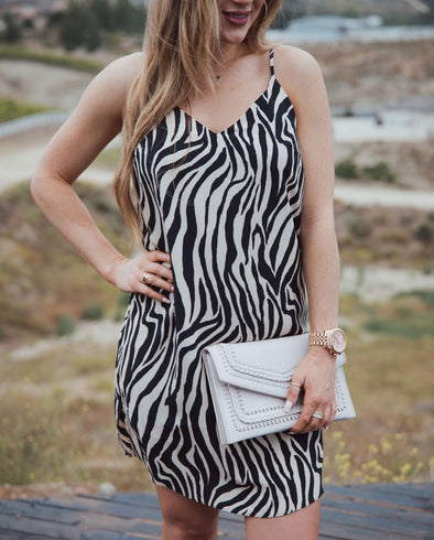Shop Naked Zebra Dress Show us your wild side! Pair this with your favorite black sandals and your all ready for a hot summer day! 46.00 USD // ShopBellaAllure.com