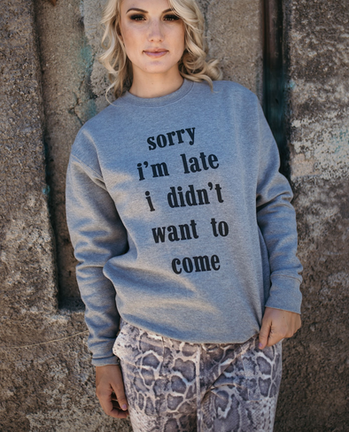 Shop Sorry I Am Late Top When you just want to be a little sarcastic - have some fun in this top. This washed fleece graphic sweatshirt is great for those casual days. Pull your hair back in a messy bun, put on some leisure bottoms, sneakers and this sweatshirt and your ready! 42.00 USD // ShopBellaAllure.com