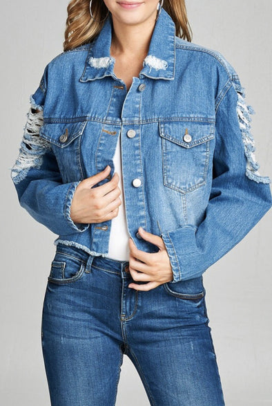 Shop What Goes On Distressed Denim Jacket A trendy spin on the classic denim jacket - our What Goes On distressed denim jacket is giving us great vibes. This cropped piece features two front breast pockets and shredded details on the back and both arms. 42.00 USD // ShopBellaAllure.com