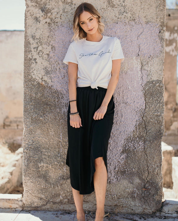 Shop Acena Skirt This free flowing smocked waist skirt will have you ready to go anywhere anytime! Its simple yet so chic. Wear it as seen here with a simple tee for a casual vibe or dress it up with a blazer, blouse and cute heels! Wherever you are going you can count on the Acena Skirt to get you there in style! 42.00 USD // ShopBellaAllure.com