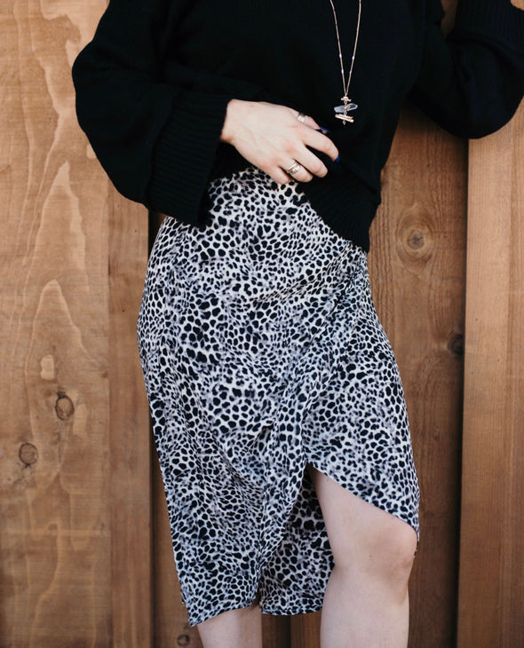 Shop Tiana Skirt Our Tiana Leopard Mid Skirt demands attention. Designed with a cross over front slit, soft silky feel and zip up back closure this printed skirt flatters the figure. A true statement piece that will take you from work to the weekend! 46.00 USD // ShopBellaAllure.com