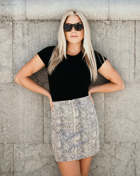 Shop Vixen Skirt Add a littler edge to your look with our Vixen Skirt. Designed with a slight stretch snake fabrication, this edgy mini comes detailed with a silver pull zipper front. Its a go anywhere, day to night skirt. 42.00 USD // ShopBellaAllure.com