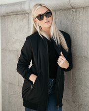 Shop Bella Bomber Black Jacket One of our Bella babe absolute must haves! Our Bella Bomber is unlike any other, with a heavy material to keep you warm yet soft internal lining and complete with an embellish arm pocket. This one will definitely make you want to be an outfit repeater! Cuffed bottom hem and sleeves for a fitted look BA embellished functional arm pocket Front zipper Two functional side pockets 46.00 USD // ShopBellaAllure.com