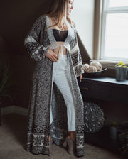 Shop Grayson Cardigan Our Grayson Cardigan is a versatile piece to have some fun with! This long flowy cardigan features long sleeves, lace detail and a front tie tassel. Wear with your favorite basic top and bottom or even as a beach cover up! 59.99 USD // ShopBellaAllure.com
