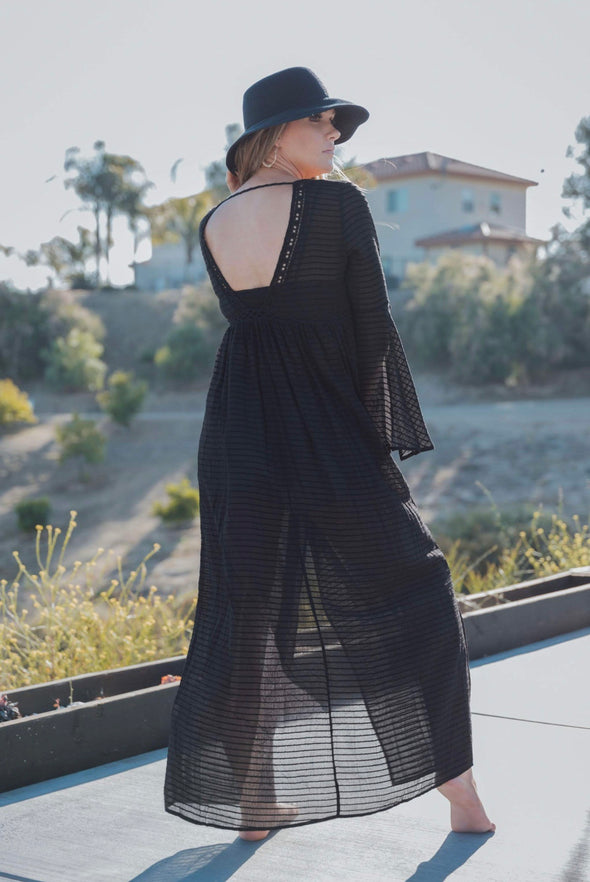 Shop Kendrick Black Kimono This unique kimono is breathtaking with its open back, slit open arms and lace front detail. Features front tie closure and lace detailed waistline. We've paired it with our Lorraine Black Bralette and our Fun In The Sun Shorts.  27.00 USD // ShopBellaAllure.com