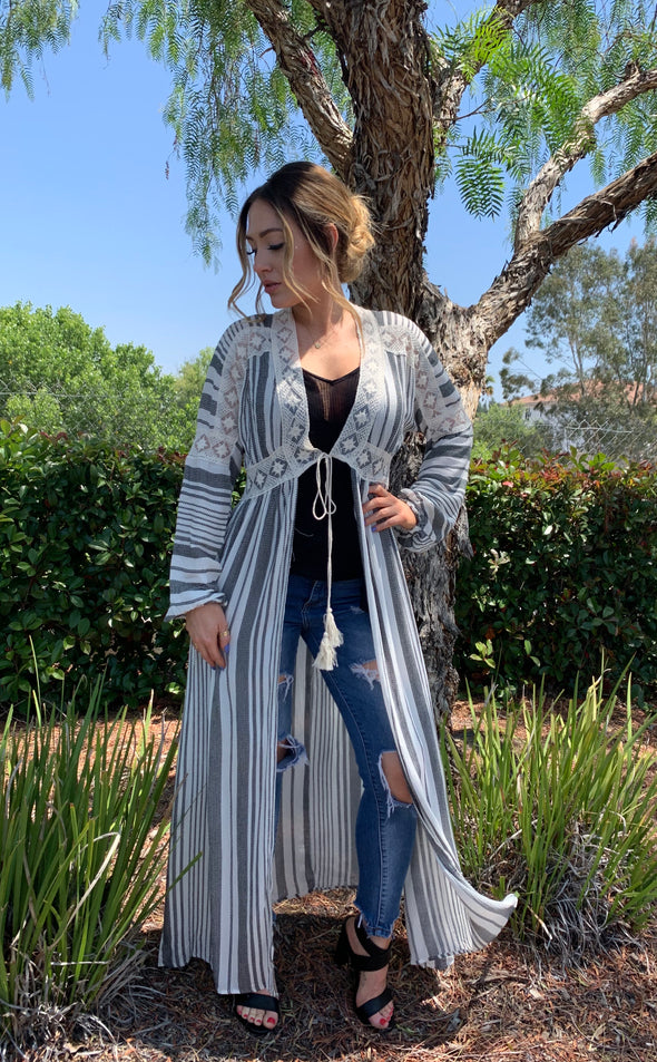 Shop Subtle Secrets Our Subtle Secrets Cardigan is a versatile piece to have some fun with! This long flowy cardigan features long sleeves, lace detail and a front tie tassel.  Wear with your favorite basic top and bottom or even as a beach cover up!   29.00 USD // ShopBellaAllure.com