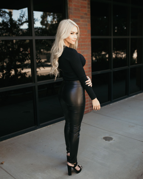 Shop Axel Pants These skinny fit faux leather pants are everything! Definitely an essential styling piece that your wardrobe needs! Our Axel pants offer a stretchy fabrication and high waistband fit for versatile styling. Styled here with our Vivian V-neck in Black. 48.00 USD // ShopBellaAllure.com
