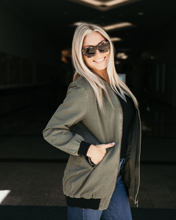 Shop Bella Bomber Olive Jacket One of our Bella babe absolute must haves! Our Bella Bomber is unlike any other, with a heavy material to keep you warm yet soft internal lining and complete with an embellish arm pocket. This one will definitely make you want to be an outfit repeater! Cuffed bottom hem and sleeves for a fitted look BA embellished functional arm pocket Front zipper Two functional side pockets 46.00 USD // ShopBellaAllure.com