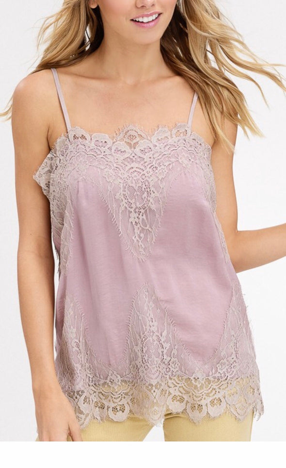 Shop Bradshaw Lace Blush Cami Sometimes the most delicate things in life gives off the loudest statement! This simple lace piece is a mandatory layering piece that dresses up all outfits. Adjustable straps that provide full coverage Delicate and dreamy Soft satin feel Lace hemlines Taupe blush color 18.00 USD // ShopBellaAllure.com