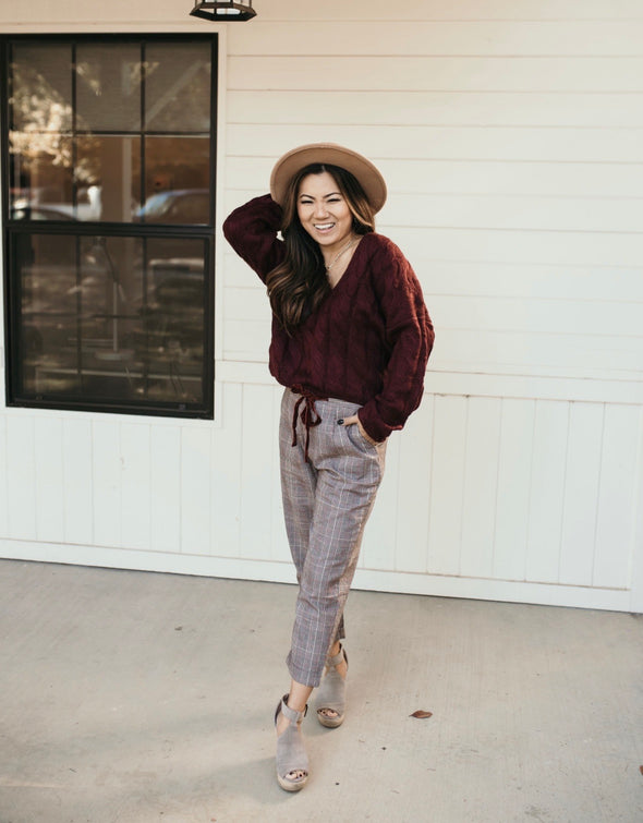 Shop Moxie Sweater Warm things up this season in our Moxie Sweater! With its beautiful burgundy color, v-neckline and relaxed fit this is a great transition piece as we head into the fall season! 46.00 USD // ShopBellaAllure.com
