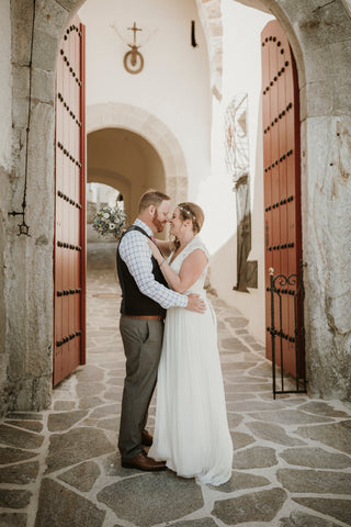 Couple embracing on their wedding day at a European castle in Austria