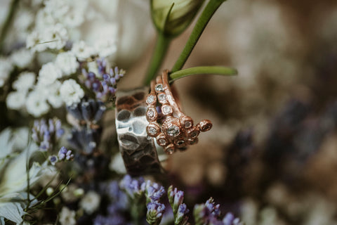 Handcrafted wedding bands in a bouquet of lavender
