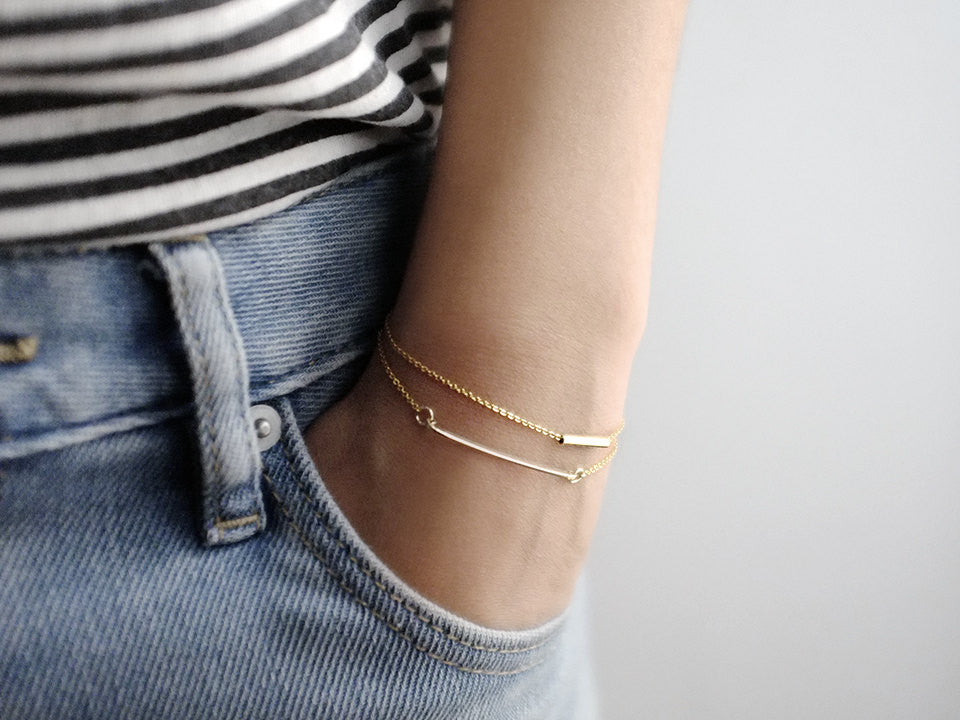 Model with LITTIONARY 14K Gold Filled Dainty Skinny Bar Bracelet